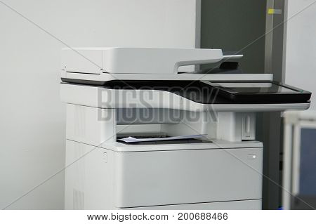 close up office printer in office for printing and scanning documents