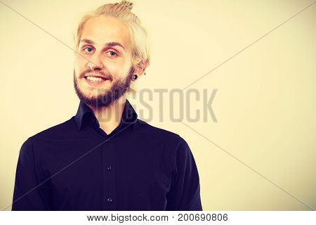 Closeup Of Smiling Blonde Man With Piercing