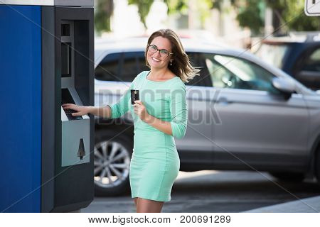 Woman pays for parking with a credit card