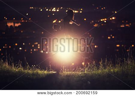 blured background of night sky with stars loving couple dancing, background night city - bokeh blurred. Concept first love, kiss, dance night, love without boundaries.