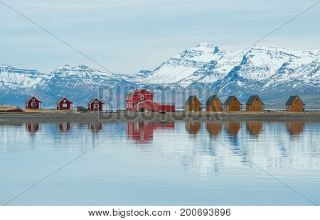 The reflection of the small cottage in Mjoeyri of Eskifjörður town in east Iceland.