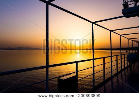 Silhouette view of the canopies girders in a passenger ship with back light from sunrise.