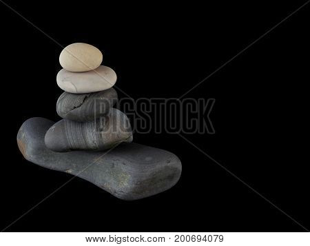 Zen stones rocks spa in stack mindfulness on  black background with reflection.
