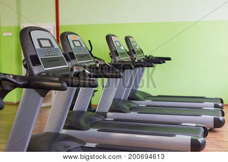 Sport, training and healthy lifestyle concept - gym interior with equipment