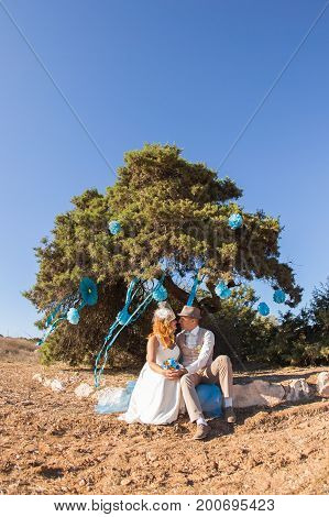 Wedding, Beautiful Romantic Bride and Groom Kissing and Embracing Outdoors.