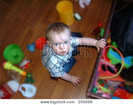 Child Surrounded By Toys