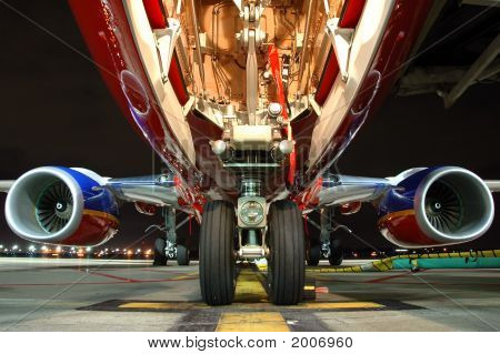 Airplane view from landing gear at night poster