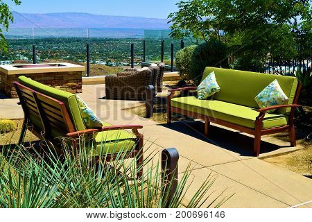 Contemporary style outdoor patio furniture including comfortable sofas with pillows at a residential garden overlooking the Coachella Valley taken in Palm Springs, CA