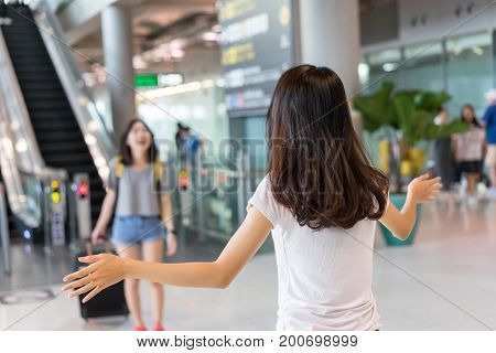 Young girl asian traveler hugging friend with carrying hold suitcase luggage and passenger after tour travel booking ticket flight in airport international vacation time in holiday relaxation.