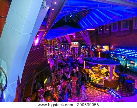 Barcelona, Spain - September 10, 2015: Royal Caribbean, Allure of the Seas sailing from Barselona on September 10 2015. The second largest passenger ship constructed behind sister ship Oasis of the Seas. Passengers walking inside the ship