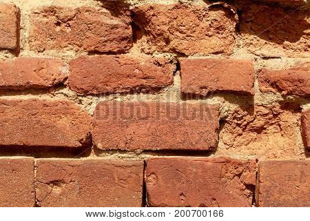 background of red bricks stacked in rows