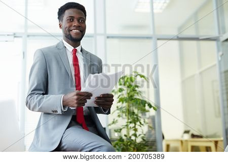 Contemporary young banker in suit working in office