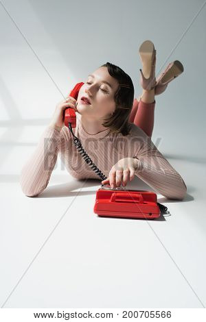 Retro Styled Girl With Rotary Telephone