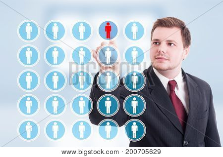 Young Businessman Pointing Contact On Futuristic Interface