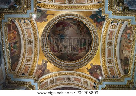 ST PETERSBURG RUSSIA - AUGUST 15 2017. Icons and decorated dome with Bible scenes in the interior of the St Isaac Cathedral in St Petersburg Russia. St Petersburg Russia landmark interior
