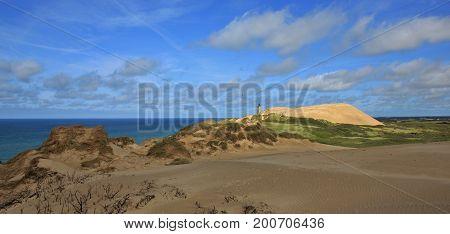 90 m high sand dune and old lighthouse. Rubjerg Knude Denmark.