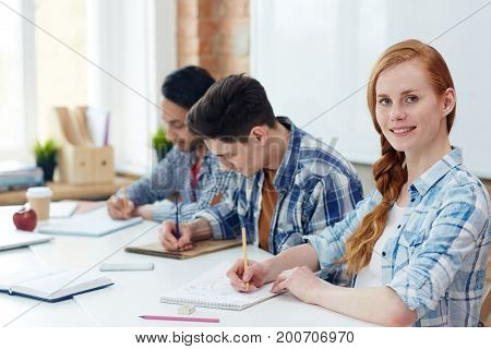 Young learners of highschool making notes or sketching in notepads