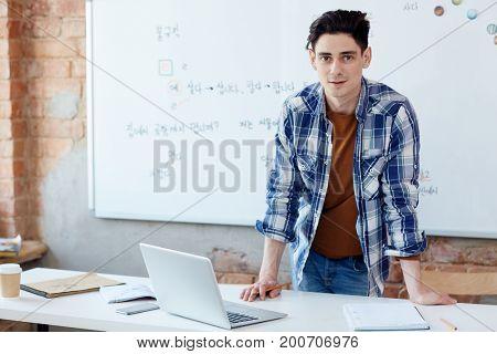 Highschool learner preparing homework after lessons at college