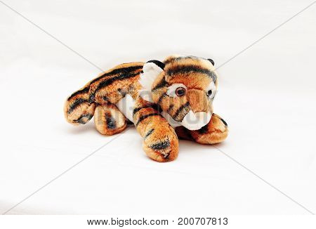 Soft children's toy striped tiger isolated white background.