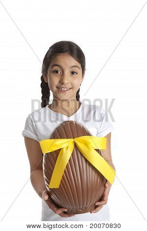 Girl with a large chocolate easter egg