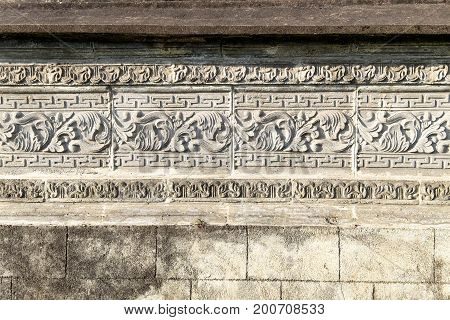 Ancient bas-relief on the wall of Besakih Temple (Pura Besakih) Bali Indonesia