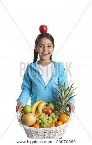 Laughing girl carrying a fruit basket