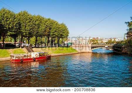 ST PETERSBURG RUSSIA - AUGUST 15 2017. Moika river and First Garden bridge in sunny day in St Petersburg Russia. St Petersburg Russia city landscape view