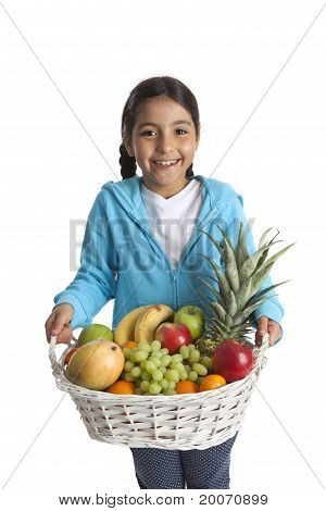 Little girl carrying a fruit basket
