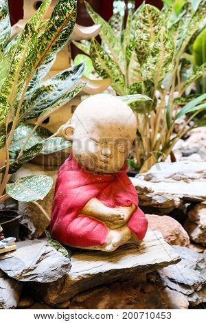 Stone carved little Buddha in garden ,Thailand