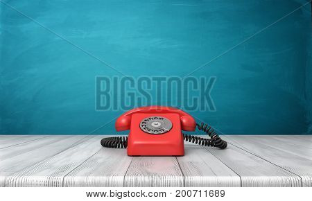 3d rendering of a bright red dial phone standing on a wooden desk and a blue wall background. Vintage appliances. Communication. Grandma phone.