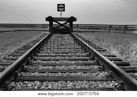 End of railway with sleepers and block