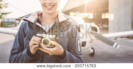 Smiling Photographer At The Airport