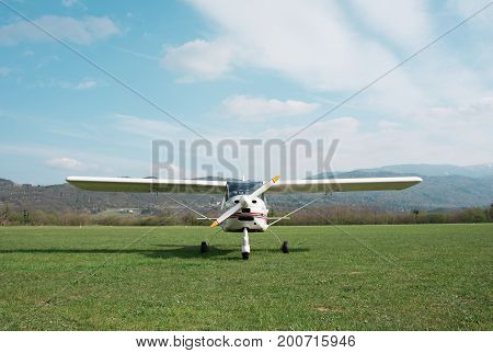 Light aircraft on the airfield grass travel and aviation concept