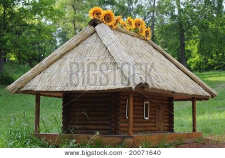 Miniature of traditional wood house under straw roof