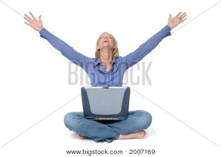 Attractive Blond On The Laptop Celebrating