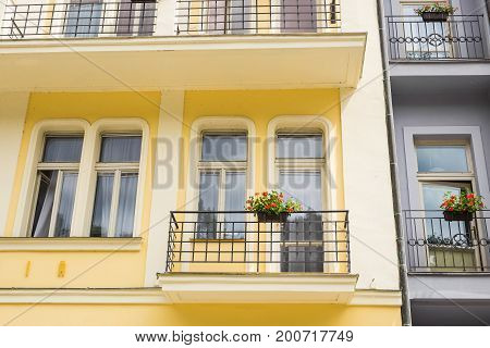 Nice balcony in classic building in Europe. balcony with flower pot