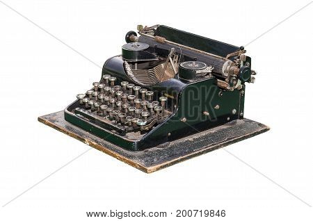 Old mechanical typewriter standing on a green plane isolated.