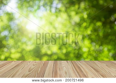 Wood Terrace Withe The Blurred Natural Green Leaves White Background. Backdrop With Color And Bright