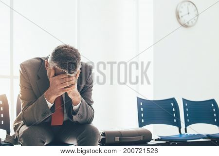 Desperate Businessman In The Waiting Room