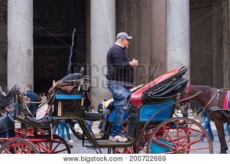 ROME ITALY - OCTOBER 20 2016: Unknown horseman on his carriage in front of the famous Pantheon in Roma