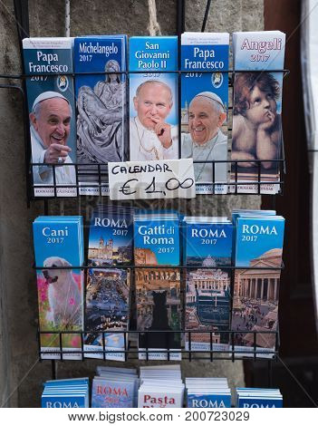 CASTEL GANDOLFO ITALY - OCTOBER 19 2016: Various pope calendars in front of a shop