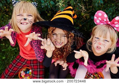 Scary halloween girls in costumes trying to frighten you