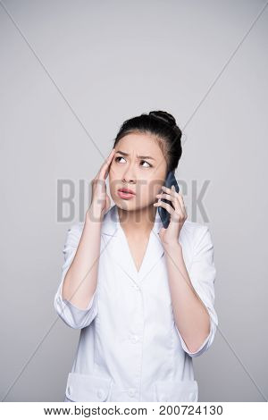 Concerned Nurse Talking On Phone