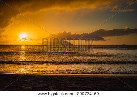 Sunset on the coast of the famous Beau Vallon beach on Mahe island, Seychelles