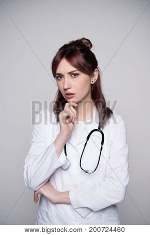 Young Female Doctor Touching Chin