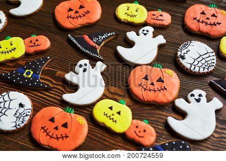 Background of decorative halloween cookies on wooden table