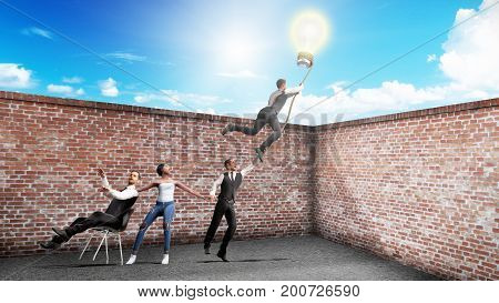 Concept Of A Successful Team Idea A Light Bulb That Pulls People Up 3D Render