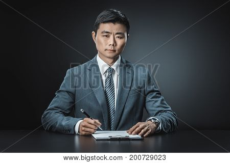 Asian Businessman With Document