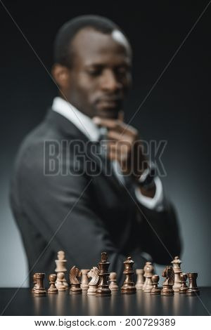 Pensive African American Businessman And Chess