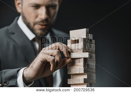 Businessman Playing Blocks Wood Game